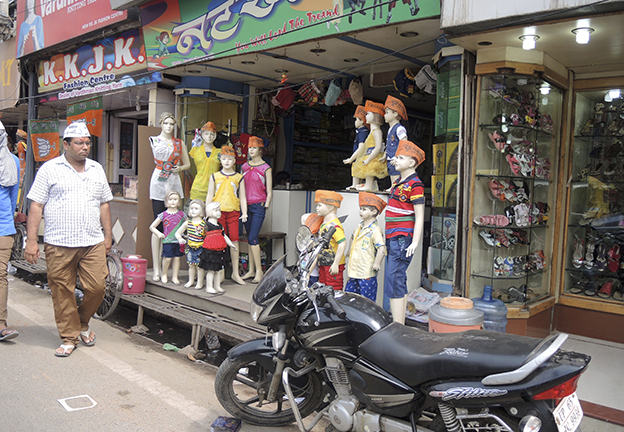 POLITICS. Competing campaign hats in Varanasi (Hull)