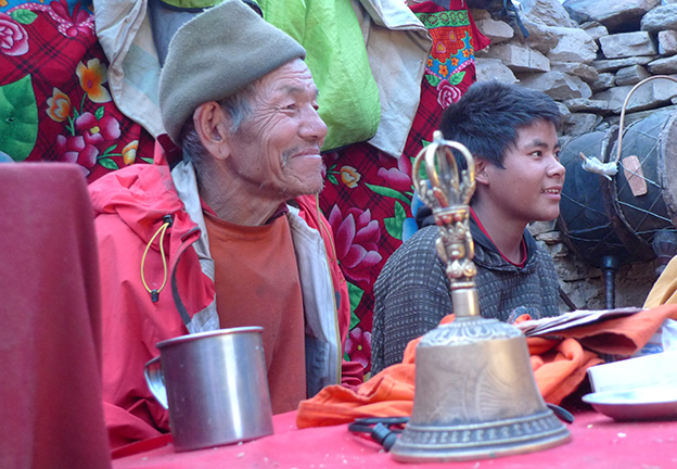 RELIGION. Young Buddhist Lama instructed by head lama in Nepal Himalayas (Fricke)