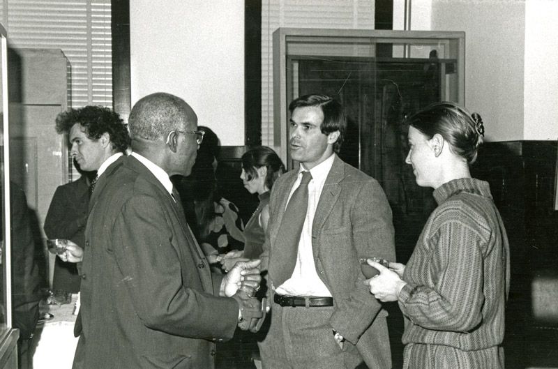 photo of three people talking.