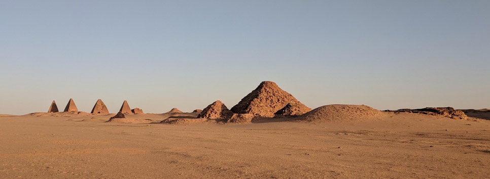 View of pyramids in desert.