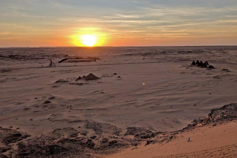 desert landscape with pyramids
