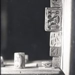 glass plate photo of Egyptian amulets