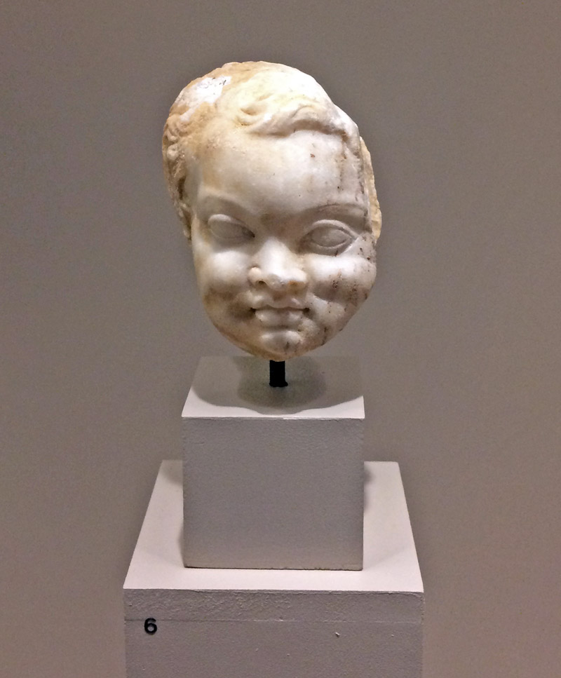 Marble head of a little boy.