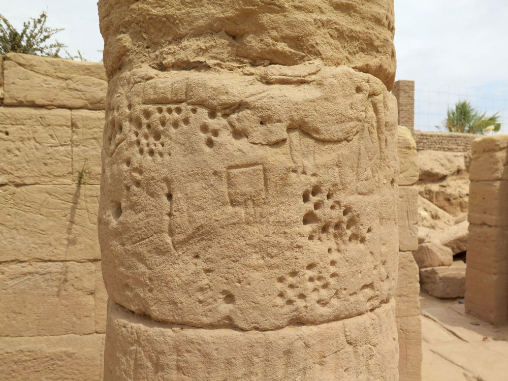 carved graffiti on a sandstone column