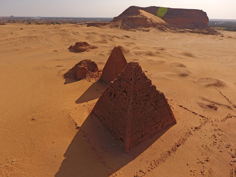 aerial view of small pyramids in the desert