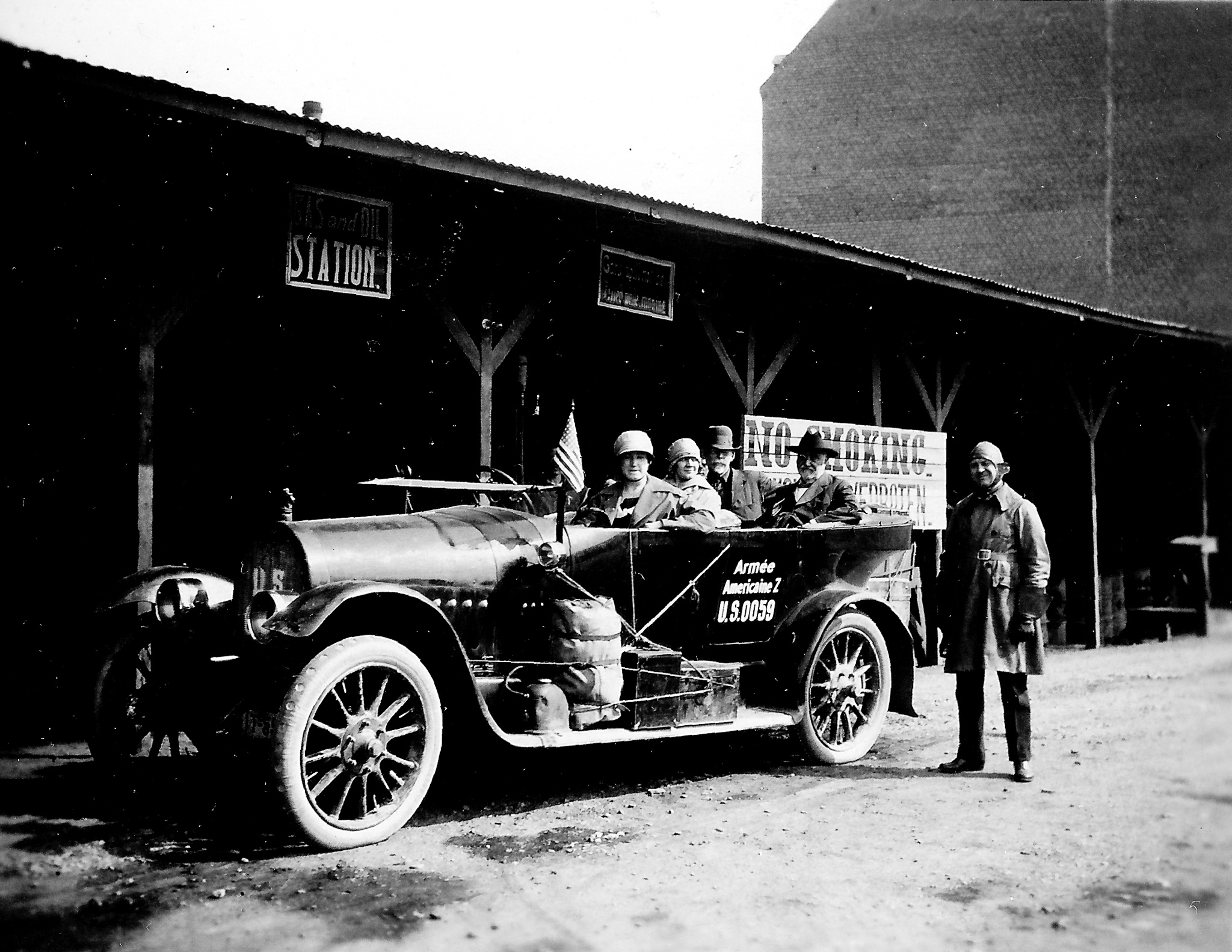 black and white photo of a 1920s car with passengers