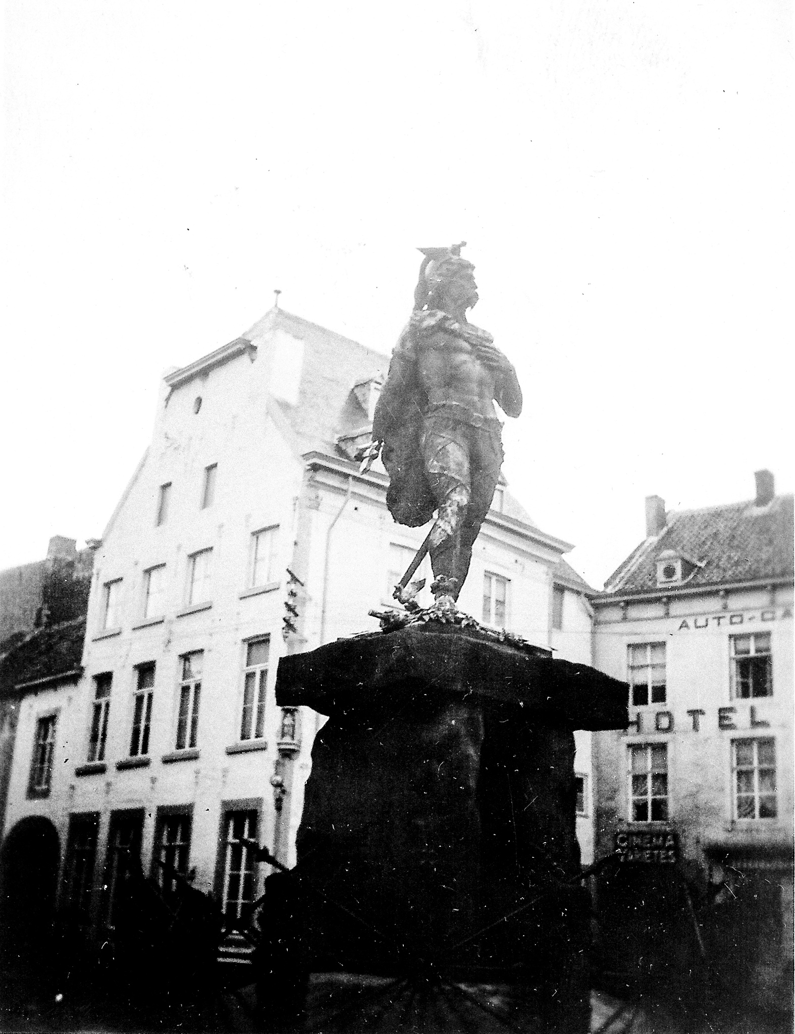 black and white photo of a statue