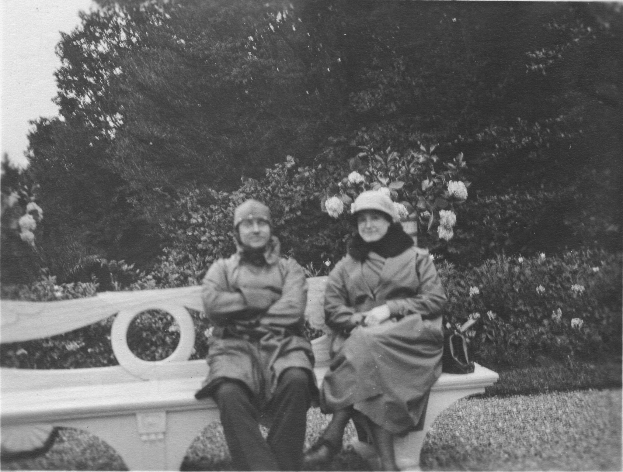 black and white photo of man and woman on a bench