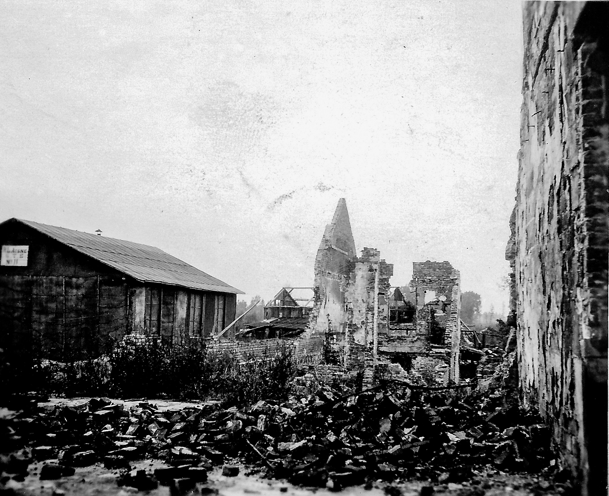 black and white photo of ruins in French village after WWI