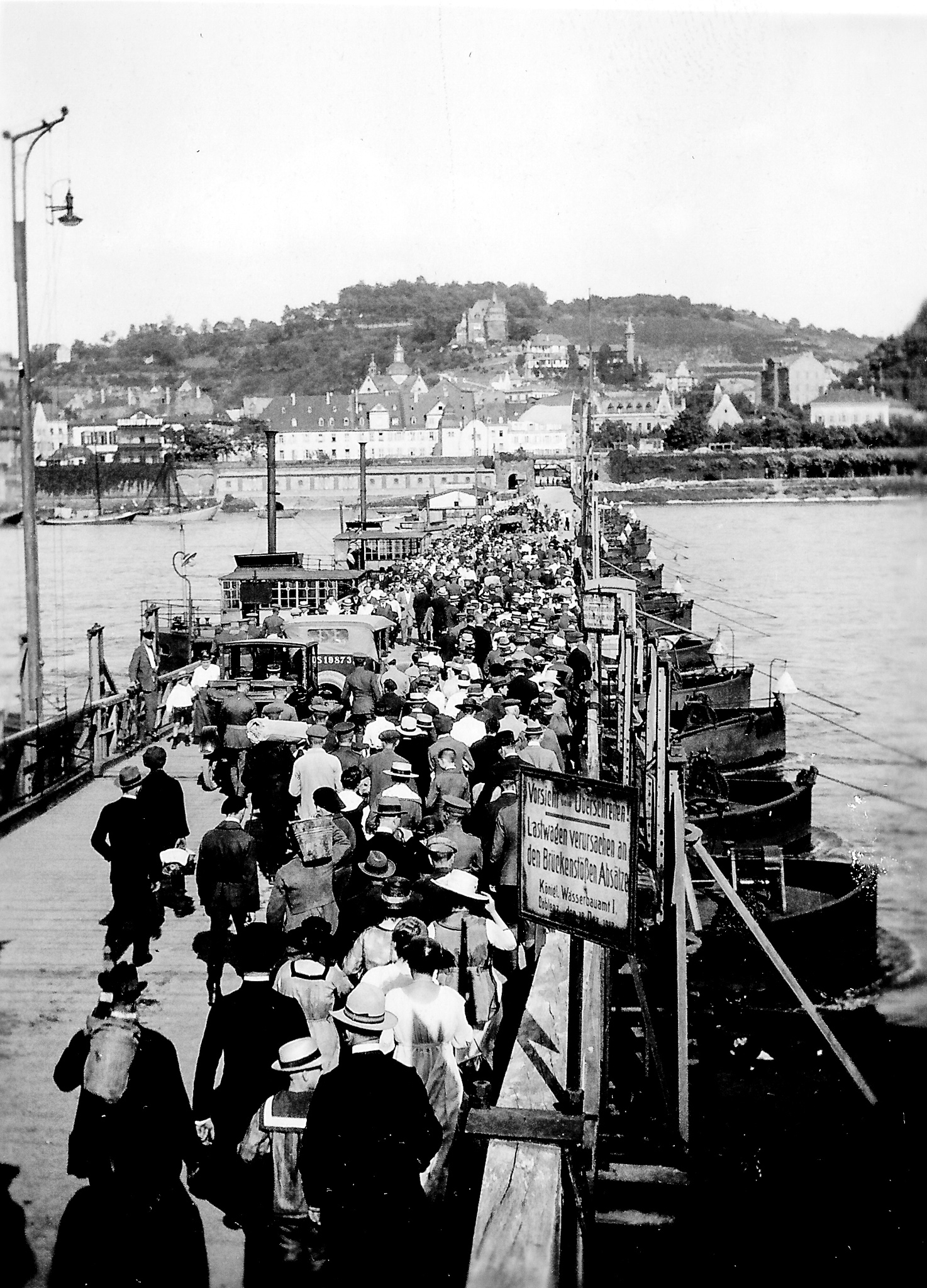 black and white photo of crowded bridge