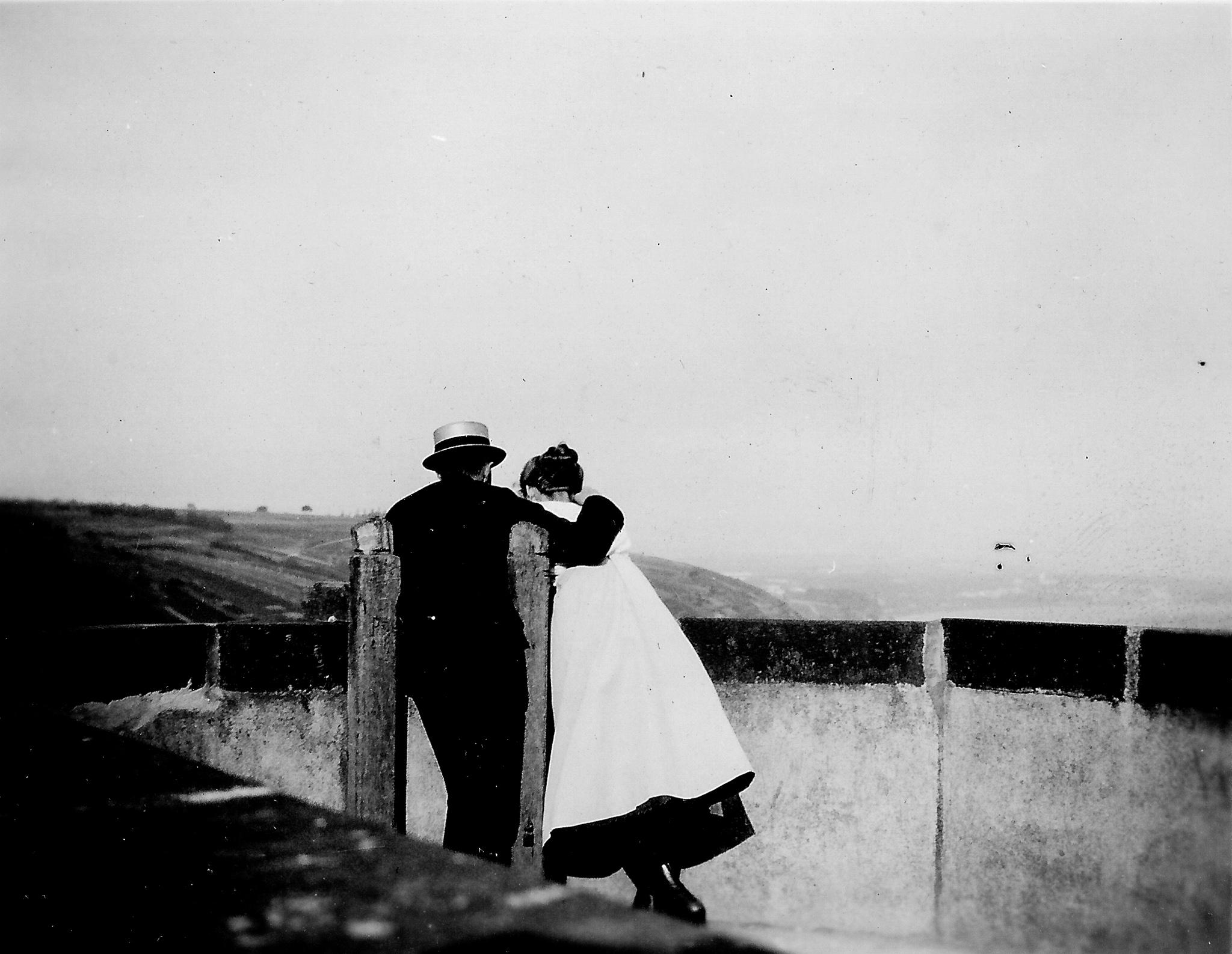black and white photo of a man and woman embracing