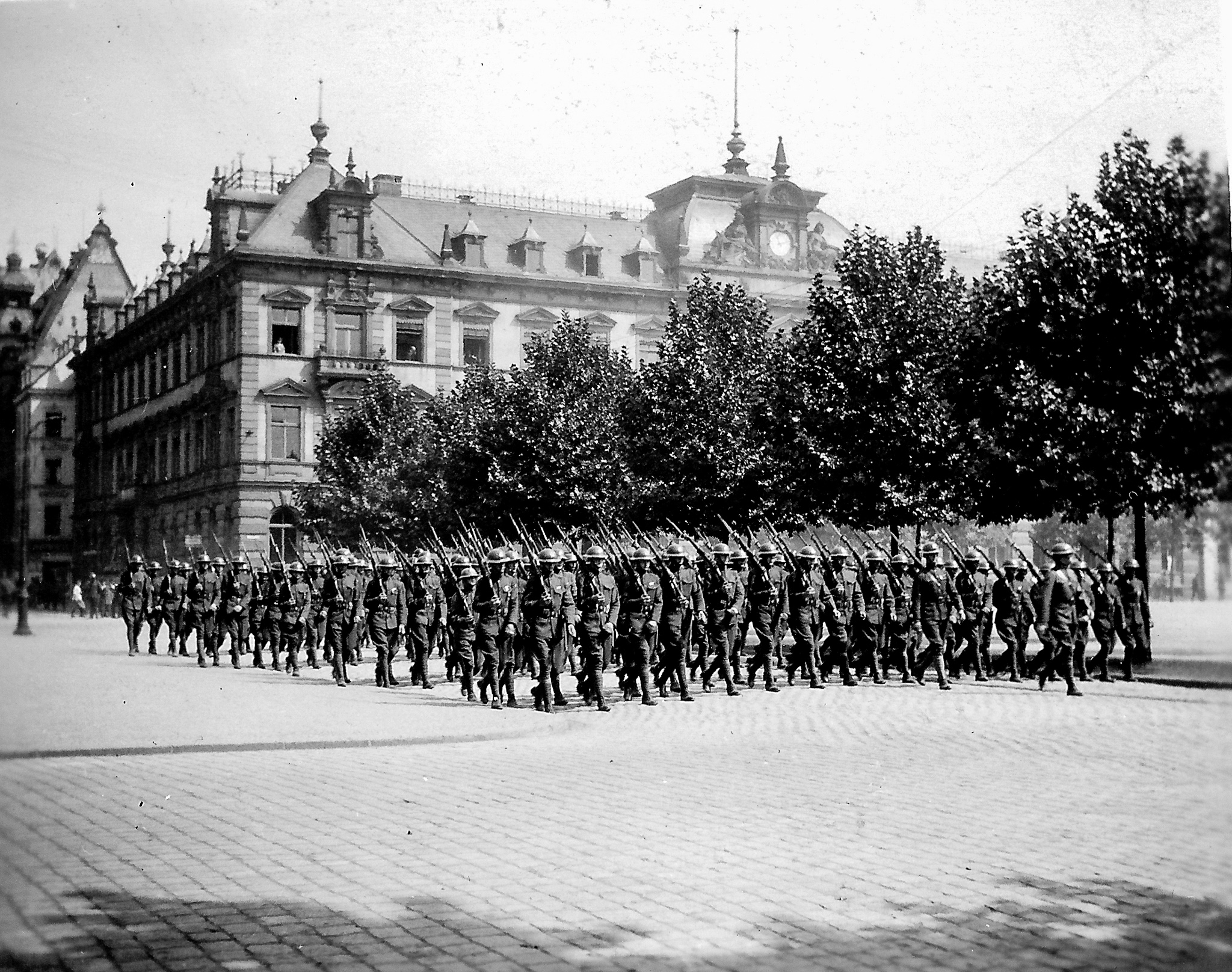 black and white photo of army troops in formation.