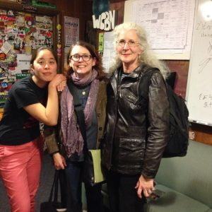Andrea Barrett poses with host T and engineer The Liz in the station lobby after the show