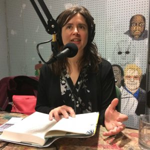 writer talking into the mic