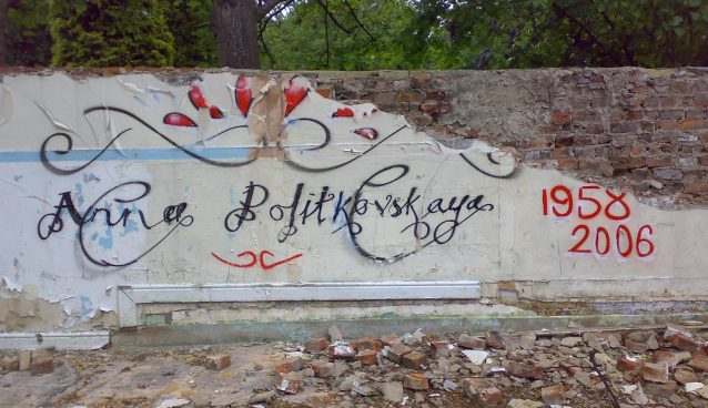 Memorial graffiti for Anna Politkovskaya with the dates 1958 and 2008 on a partially destroyed wall
