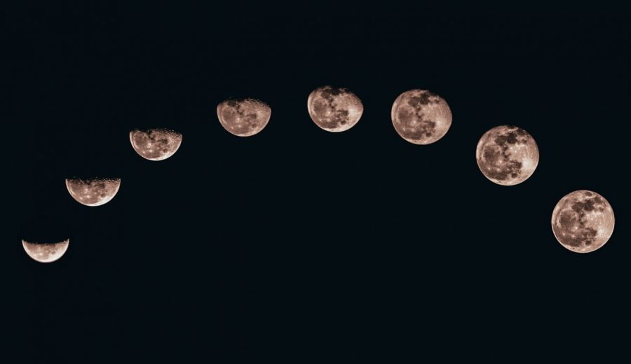 Moon phases against black background