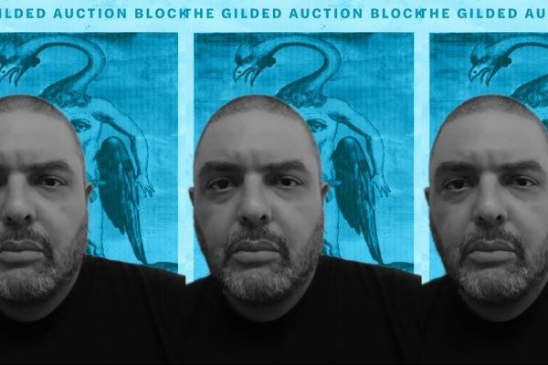 "Shane McCrae's head, from the shoulders up, in front of the cover for his book ""The Gilded Auction Block"" which features a creature with a long neck."