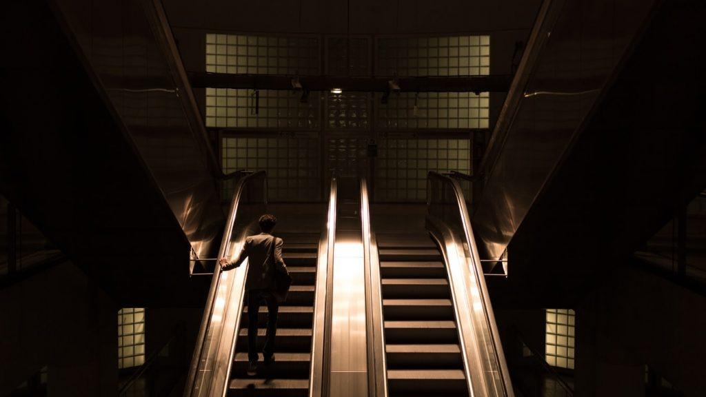 Escalator with man stock image