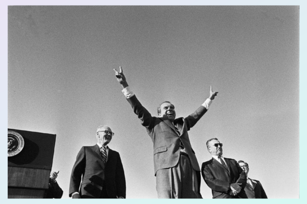 Richard NIxon, from below, give the victory wave