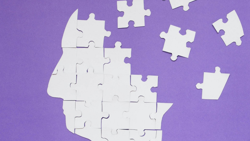 white puzzle pieces, some together, some not, against a purple background