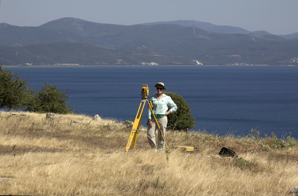 Catie Steidl surveying the site in preparation for geophysical prospection and collection of surface finds