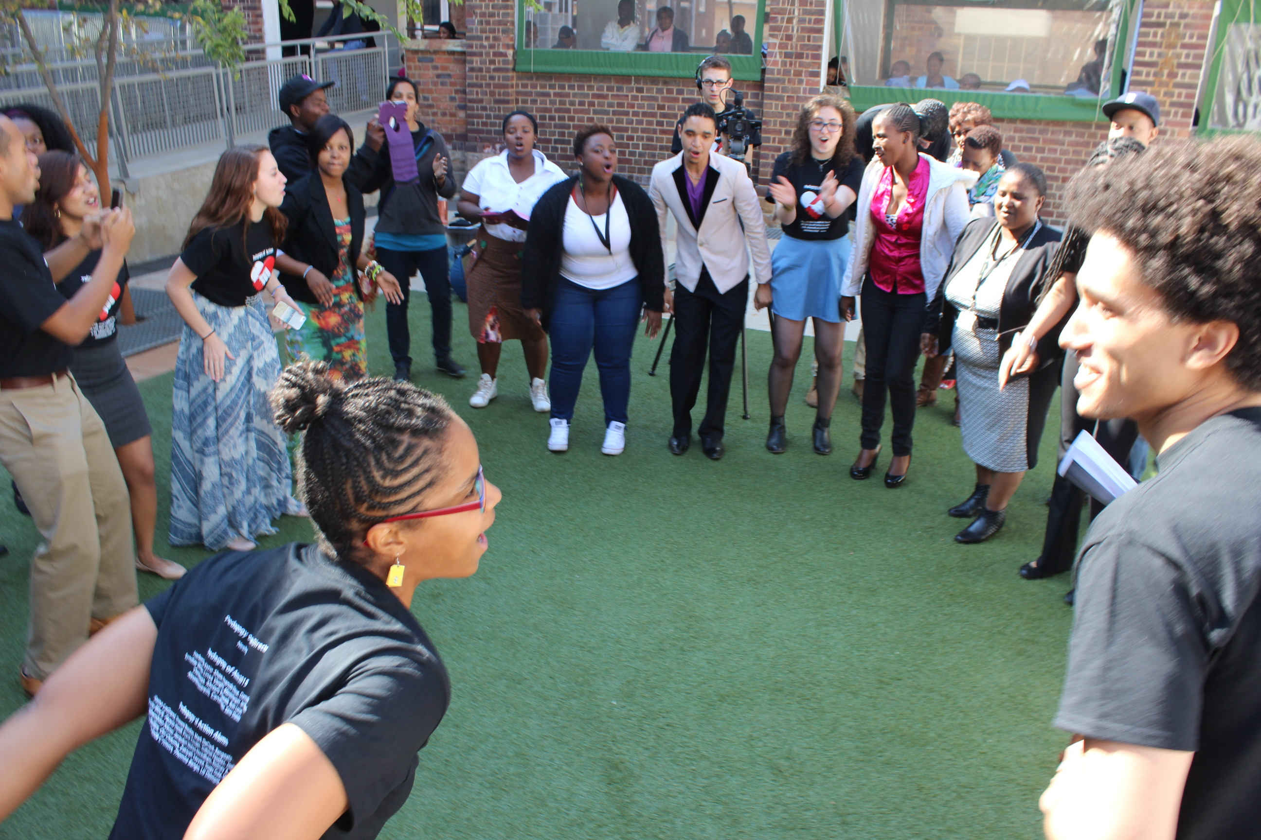 loveLife Groundbreakers and POA students dancing together at graduation ceremony