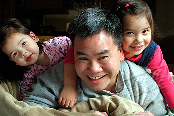 Asian Dad Playing With His Daughters