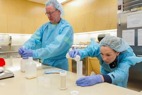 4/17/12 Dietetic Technicians Jay Jacobs and Ann Melling mix breast milk and formula in the Milk Room of Mott Children's Hospital during a Day in the Life of the University of Michigan on April 17, 2012.